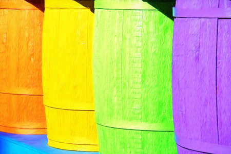 A row of vibrant colored wooden barrels. This is computer generated art from a photograph.