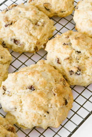 Homemade fruit scones hot out of the oven cooling on a rack.