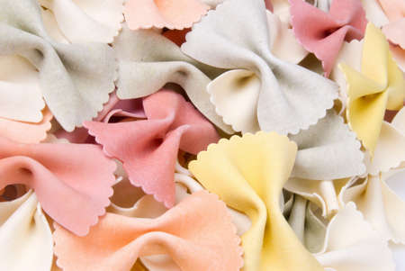 Close-up of Rainbow whole wheat bow tie pasta in a wide variety of colors Stock Photo