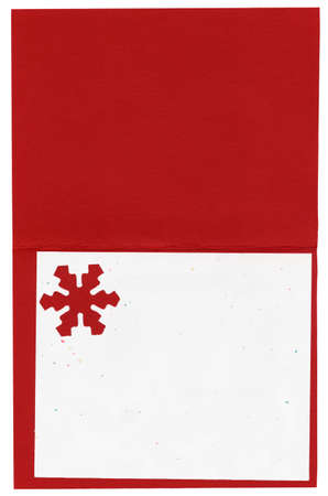 Blank high resolution winter holiday Christmas card. Red and white heavy paper card stock is the background with a snowflake cut out.