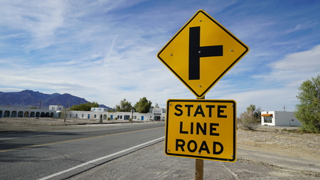 sign on state line near death valley park