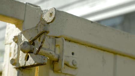 unaffected: Fading gate latch in sunlight