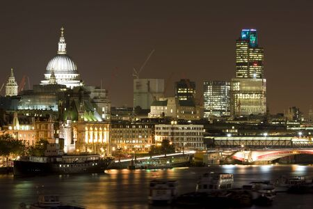 London Landscape at night, including the River Thames and offices. photo