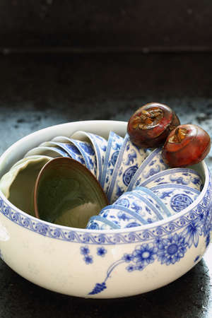 A pot of tea cups and two water chestnut