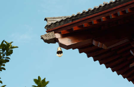 rafters: Wooden eaves of traditional style roof.
