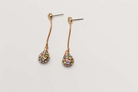 imitation: Colored imitation diamond earrings on white background