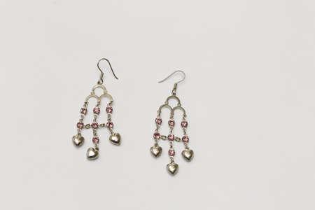 imitations: Pink diamond earrings on white background Stock Photo