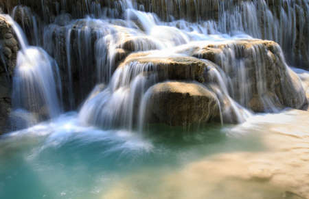 rushing water: Green rushing water flowing over rocks Stock Photo