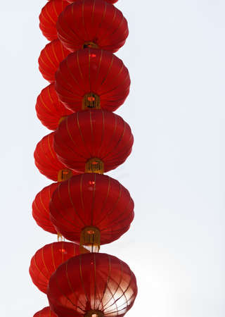 cascading: cascading chinese red lanterns against white background