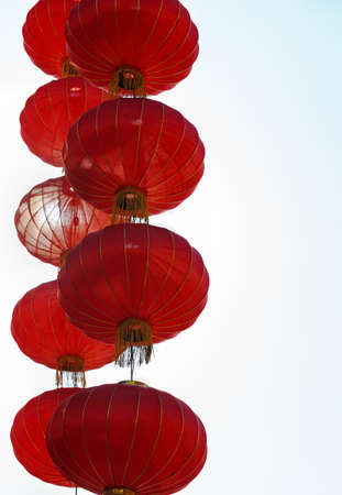 against white: cascading chinese red lanterns against white background