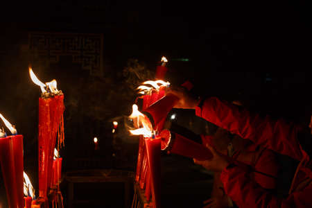 customs and celebrations: Burning Red candles, Chinese temples, burning candles, Stock Photo