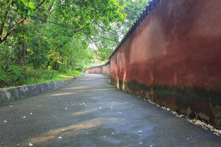 Passage between red walls Stock Photo