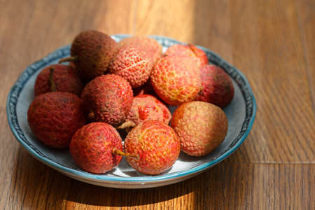 irradiation: A plate of fresh litchi Stock Photo