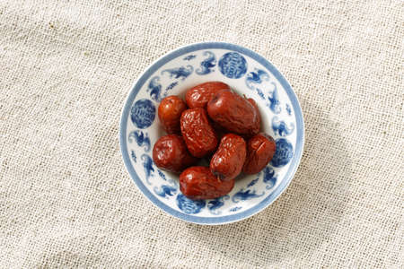 The blue and white porcelain plate with  Red dates