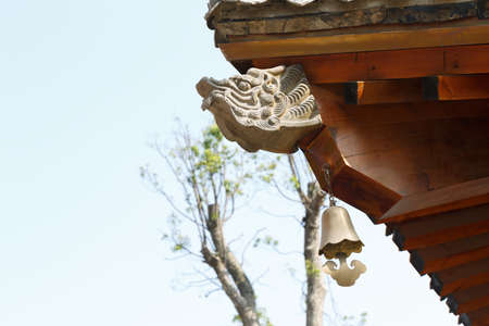 Dragon stone carving and wood roof