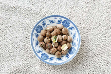 lotus seeds: The blue and white porcelain plate with Lotus seeds