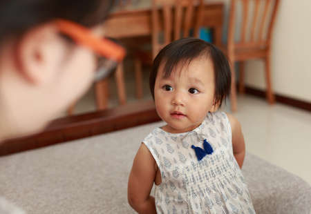 two year: A two year old Chinese girl, big eyes looked at her mother