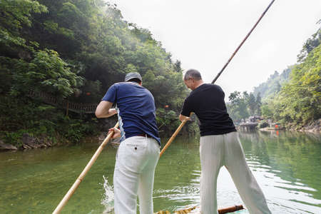 punting: Two men punting on the river