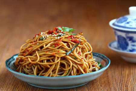 A bowl of tea and Cold Noodles with Sesame Sauce