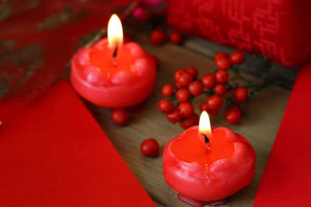 gules: Two burning candles Stock Photo