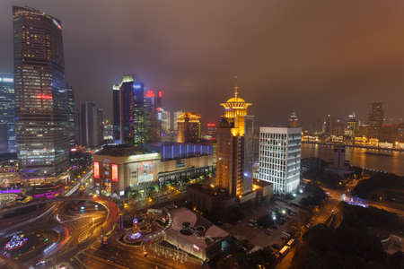 Shanghai,China - on December 20, 2016 ,Pudong, Lujiazui   ,the commercial street scene at dusk, Lujiazui  is one of the most prosperous neighborhood in Shanghai Editorial