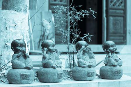 Four little monks, Zen ornaments Stock Photo