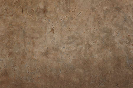 A yellowish mottled wall background