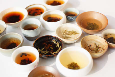 Combinations of tea and teacups of all types on white background