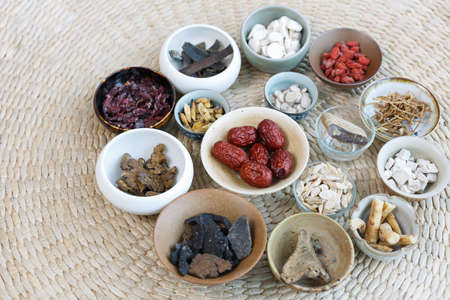 variety of Chinese herbal medicine in the porcelain cup