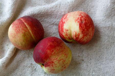 Fresh peaches are on white background. Reklamní fotografie