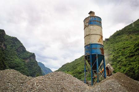 Concrete mixer in river valley