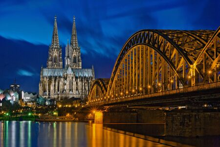 historically: cathedral and hohenzollern bridge cologne, germany Stock Photo