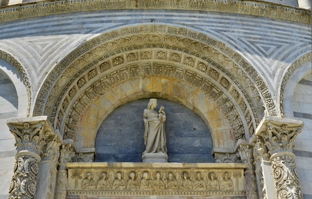 stone figures details cathedral of pisa photo
