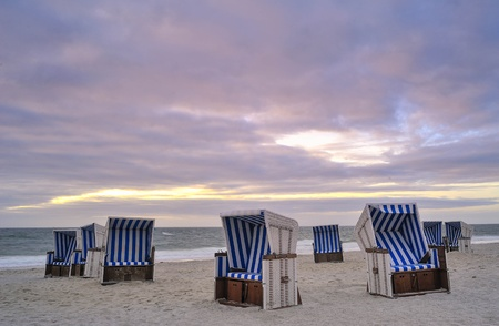 wadden: Beach chairs at the beach of Island Sylt, Germany  Stock Photo