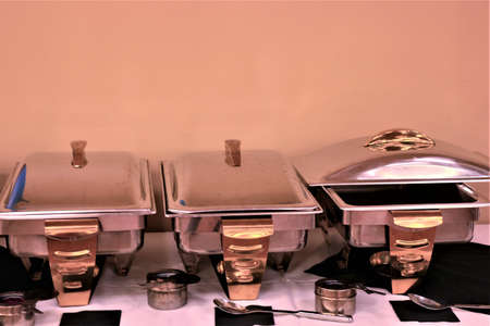 Heating trays at a buffet.