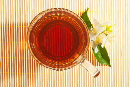 jasmine tea with jasmine flowers directly above photo