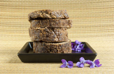 handmade african black soap with flowers  photo