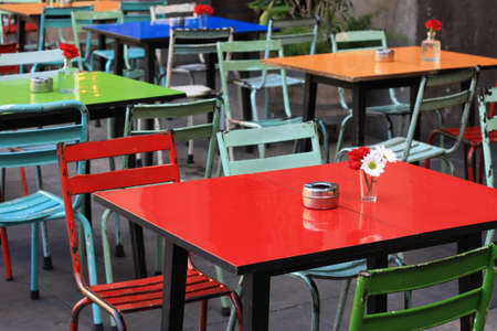 outdoor cafe: Colorful outdoor cafe tables.