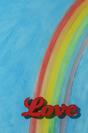 true self: The word love with a background rainbow, illustrating the concept of love, lust, desire and joy in a portrait format. Stock Photo