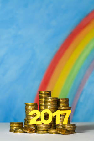 Gold coins and the number 2017 illustrating the concept of good fortune and luck with money in the new year 2017.