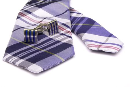 Two cufflinks on a tie. photo