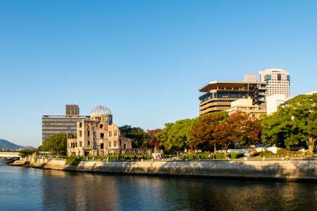 Hiroshima landscape with the view of The Hiroshima Peace Memorial (Atomic Bomb Dome) and Motoyasu River sunset in Hiroshima, Japan.