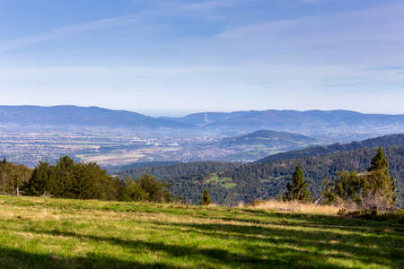 Zywiec Basin (Valley) landscape in Beskid Mountains, Poland, with green forests, meadows and Zywiec Lake, Zar mountain, seen from the hill in Milowka, Poland. Stock fotó