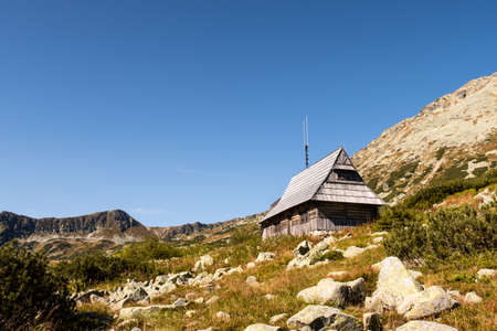 Wooden mountain hut on a glade in Five Polish Ponds Valley in Tatra Mountains, Poland.