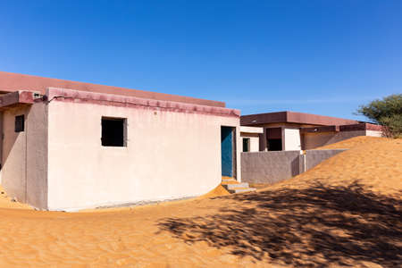 Abandoned settlement buried in sand in Al Madam ghost village in Sharjah, United Arab Emirates.