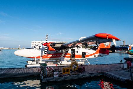 Male, Maldives, 20/11/2020. Trans Maldivian Airways seaplane Twin Otter Series 400 docked at seaplane terminal.