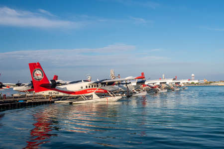 Male, Maldives, 20/11/2020. Trans Maldivian Airways terminal and dock, with seaplanes Twin Otter Series 400 fleet docked.