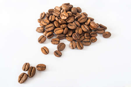 slide of roasted coffee beans on a white background for advertising coffee 스톡 콘텐츠
