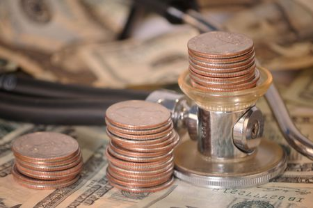 doctor money: macro of stacks of quarters on a stethescope with a background of twenty and fifty dollar bills  Stock Photo