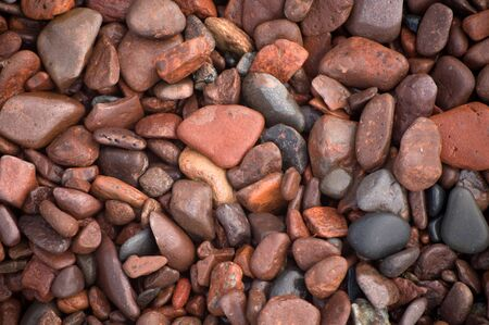 leif: macro closeup of colorful rocks along Lake superior at Leif Erickson Park in Duluth Stock Photo